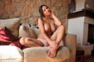 Lacey banghard  pink on sofa.